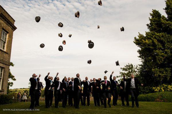 Groomsmen throwing hats