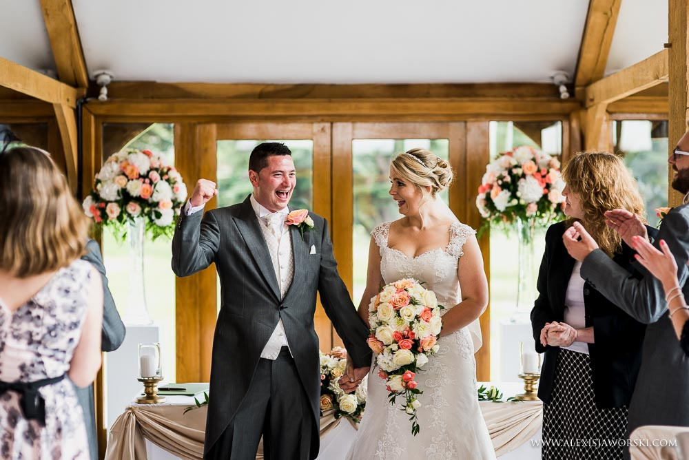 Fist pump by groom