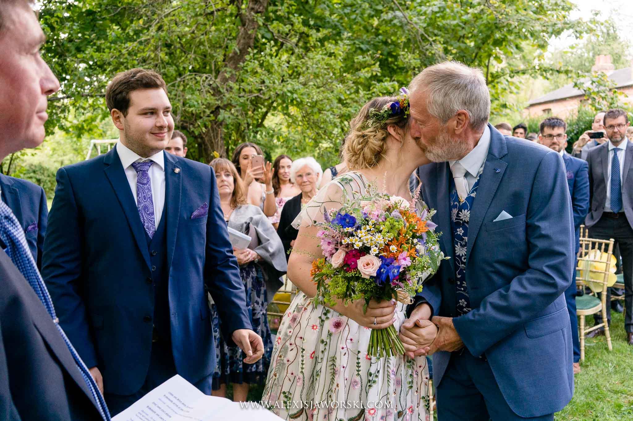 bride kissing dad