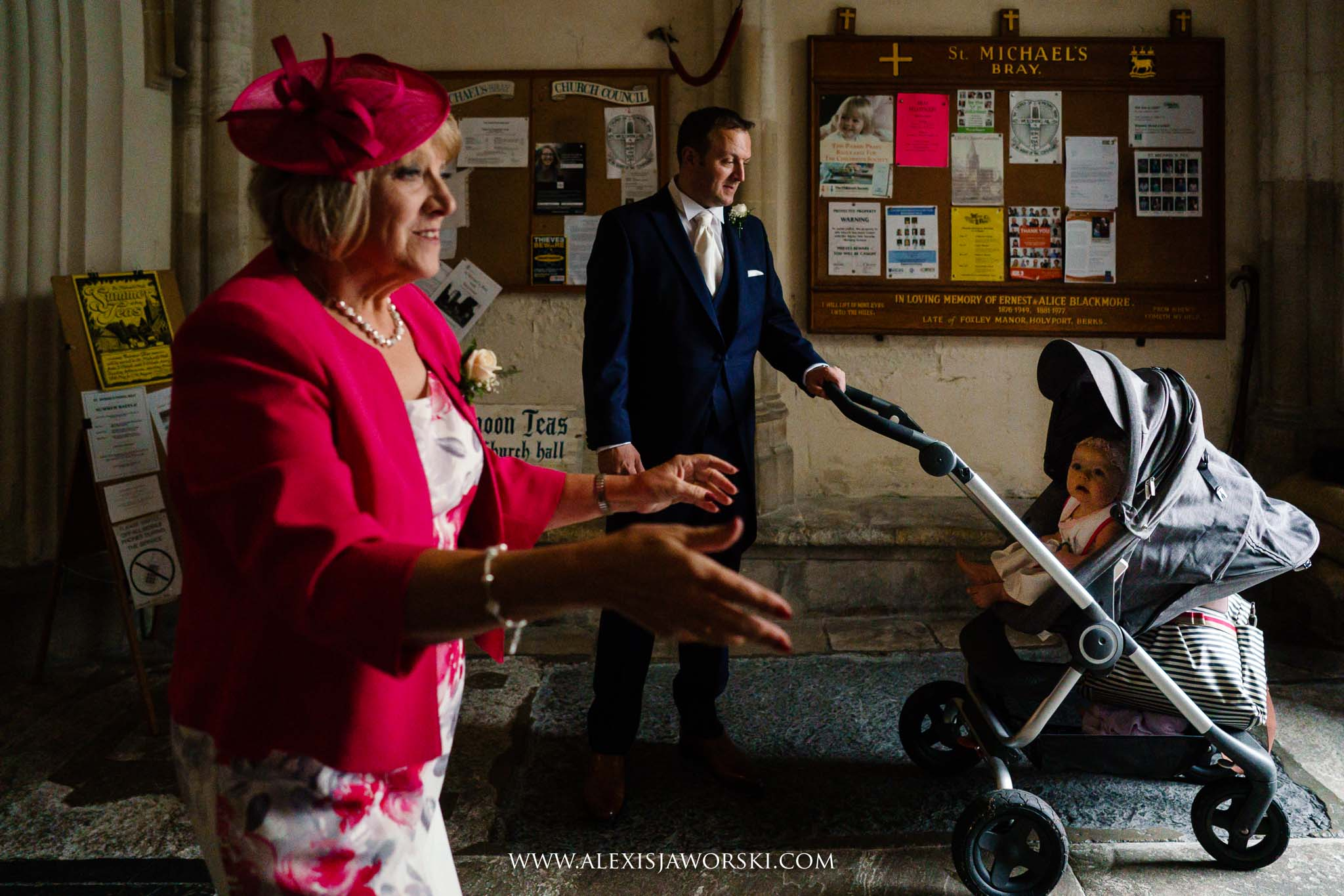 mum and groom greeting guests