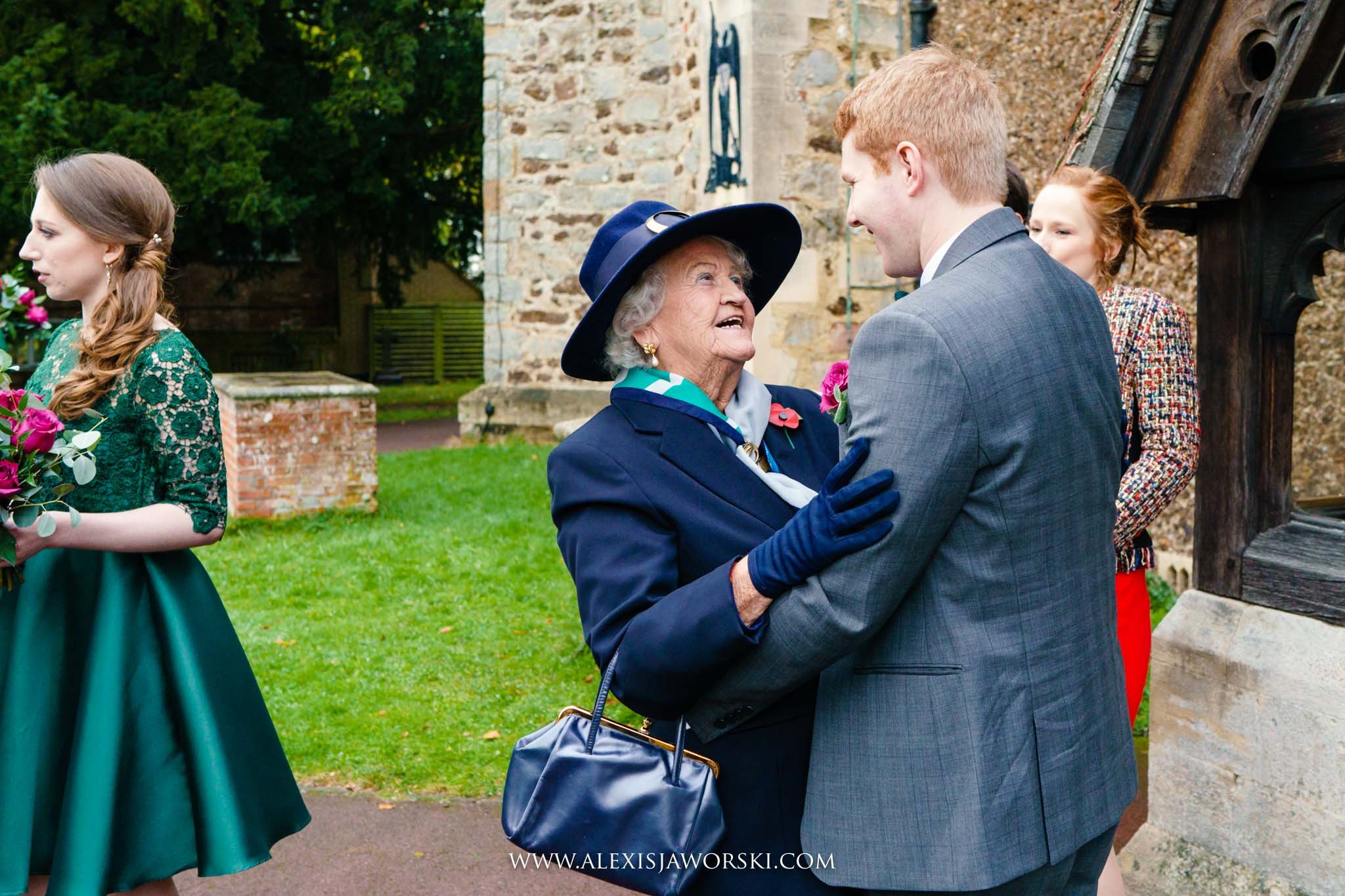 groom hugging grandma
