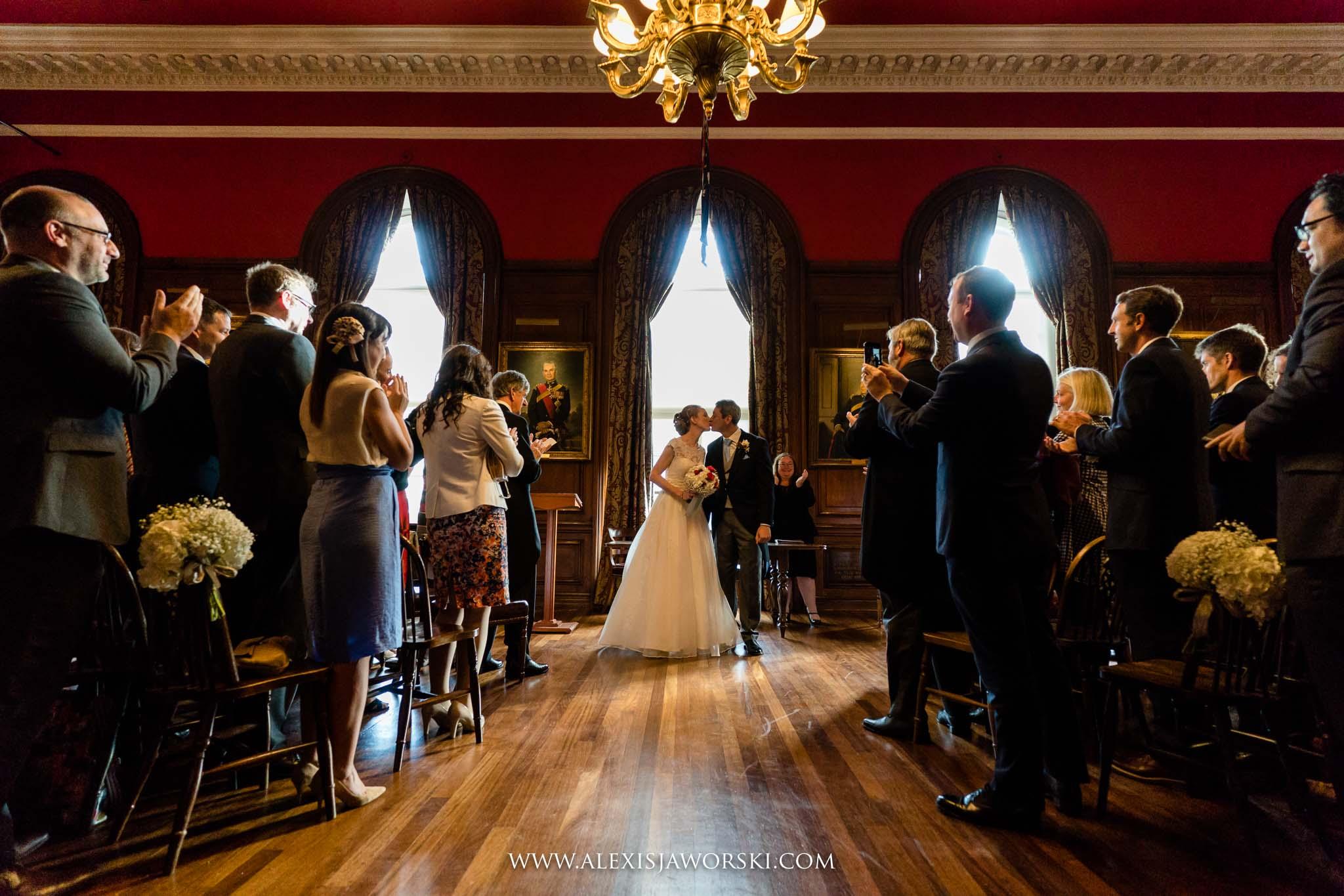 bride and groom kiss before leaving