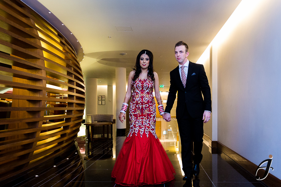 briden and groom making entrance at the hilton heathrow hotel