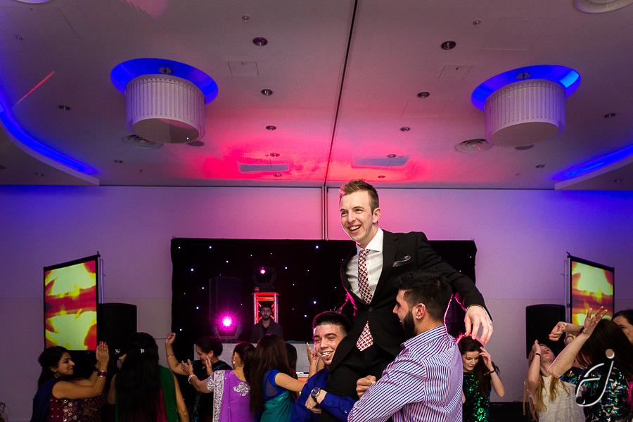 groom dancing at london heathrow hotel