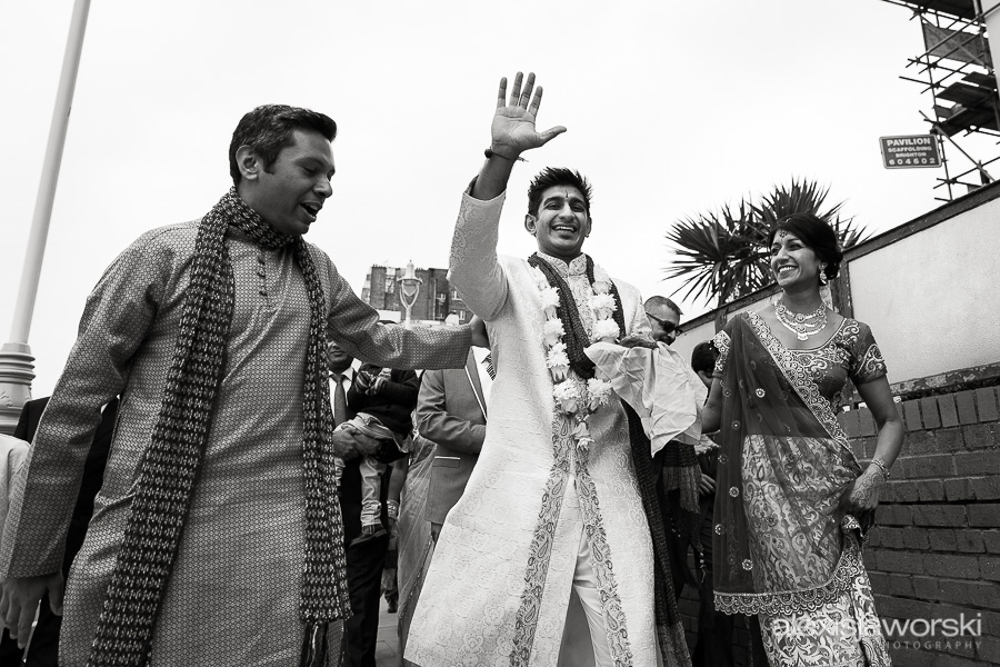 groom arriving at hindu wedding in brighton