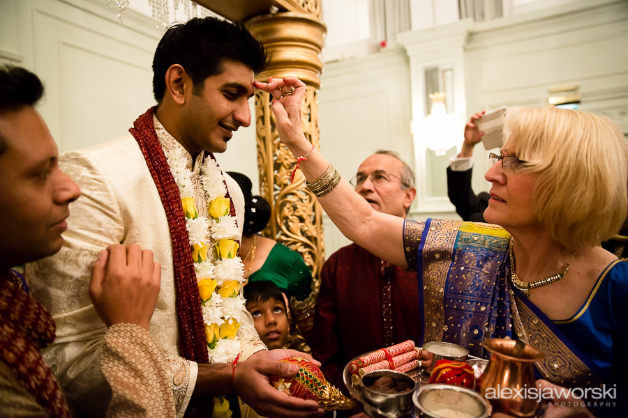 Mother of the bride greeting groom at hindu wedding