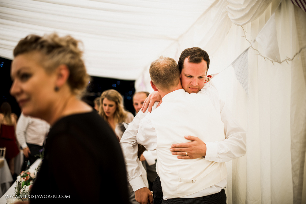 Groom and brother hug at Hamswell House