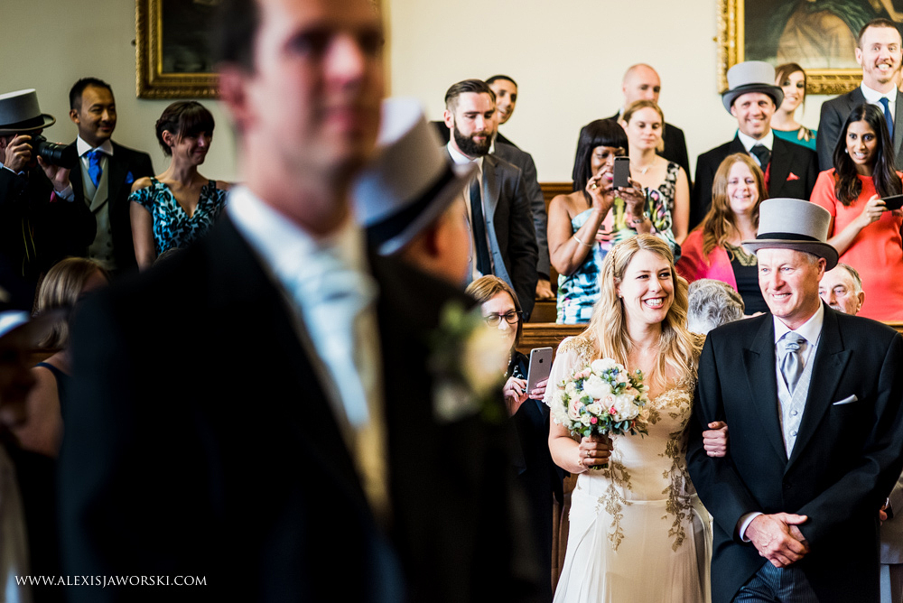 Bride wlaking down the aisle at  Guildhall in Bath