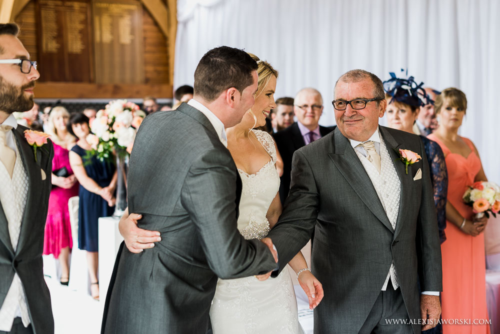 groom and father of the bride handshake