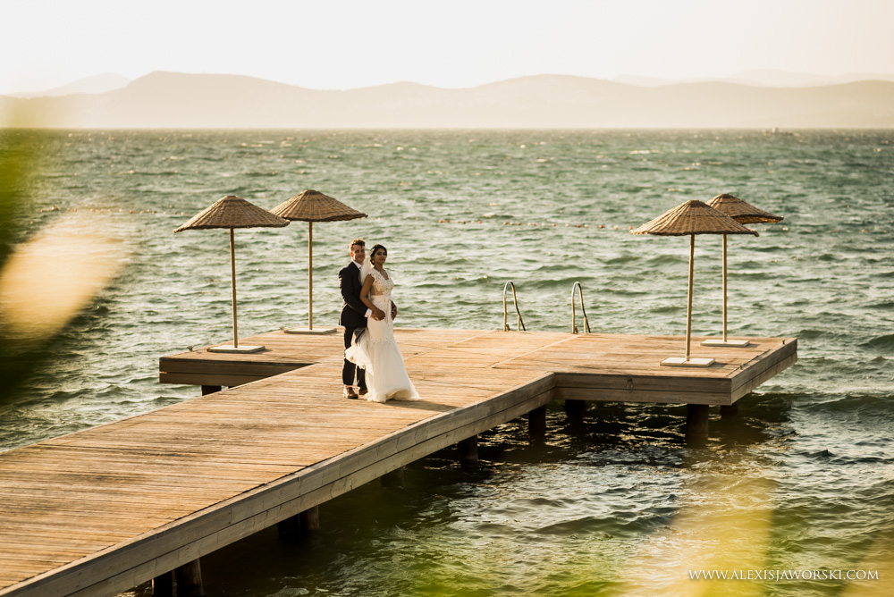 Bride and groom portrait by the pier