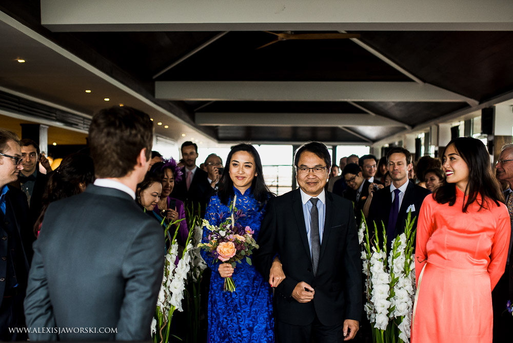 Vietnamese bride walking down the aisle in London