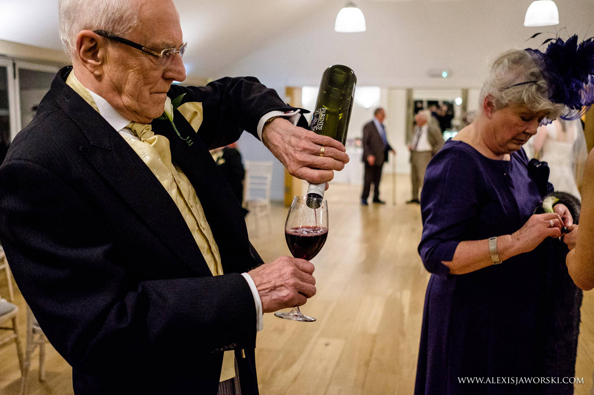 father of the groom drinking