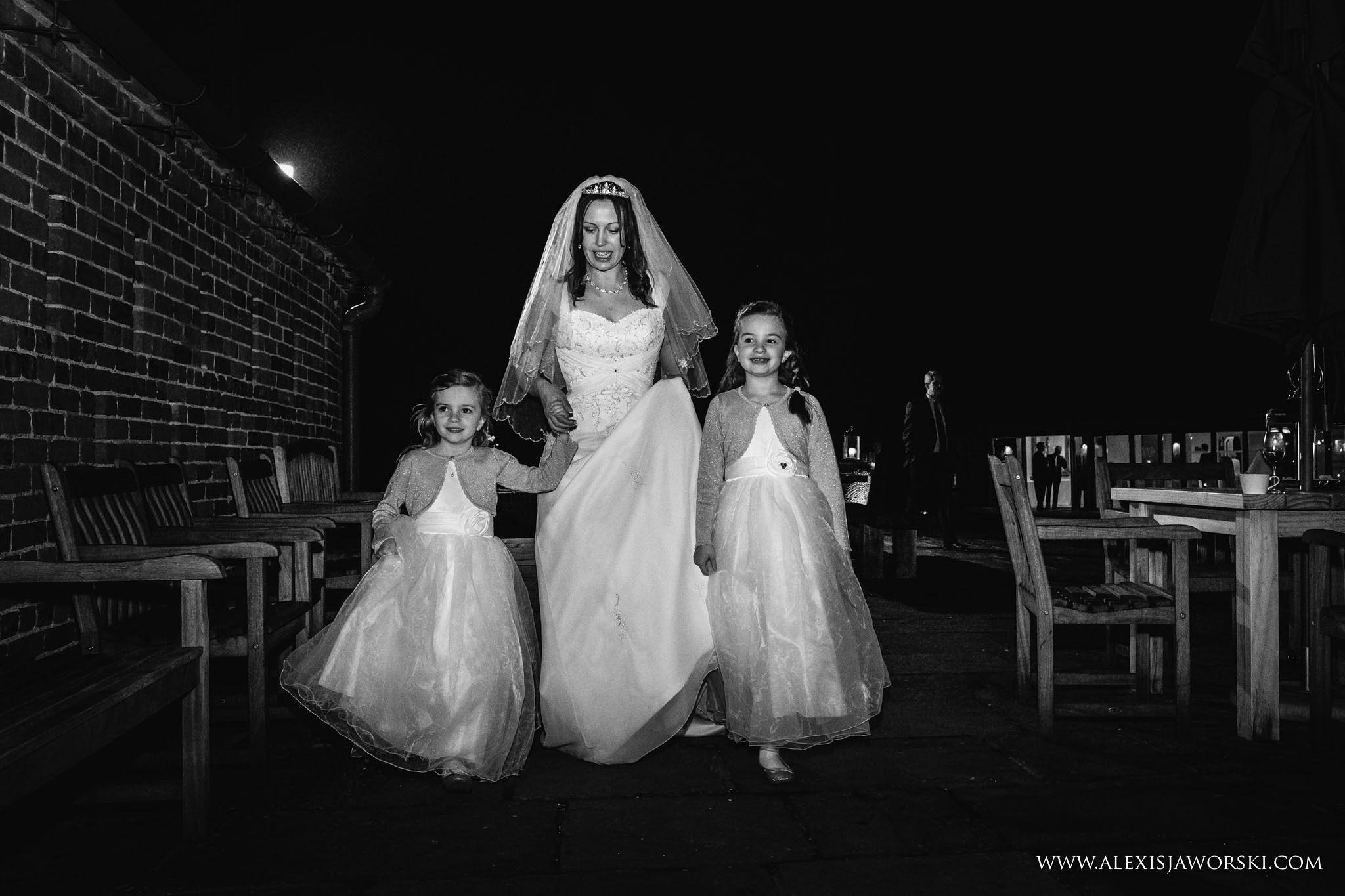 bride walking with flower girls
