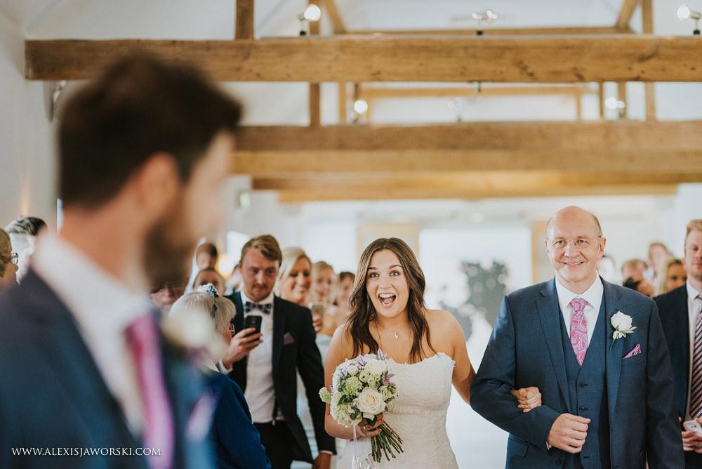 Bride happy reaction seeing the groom
