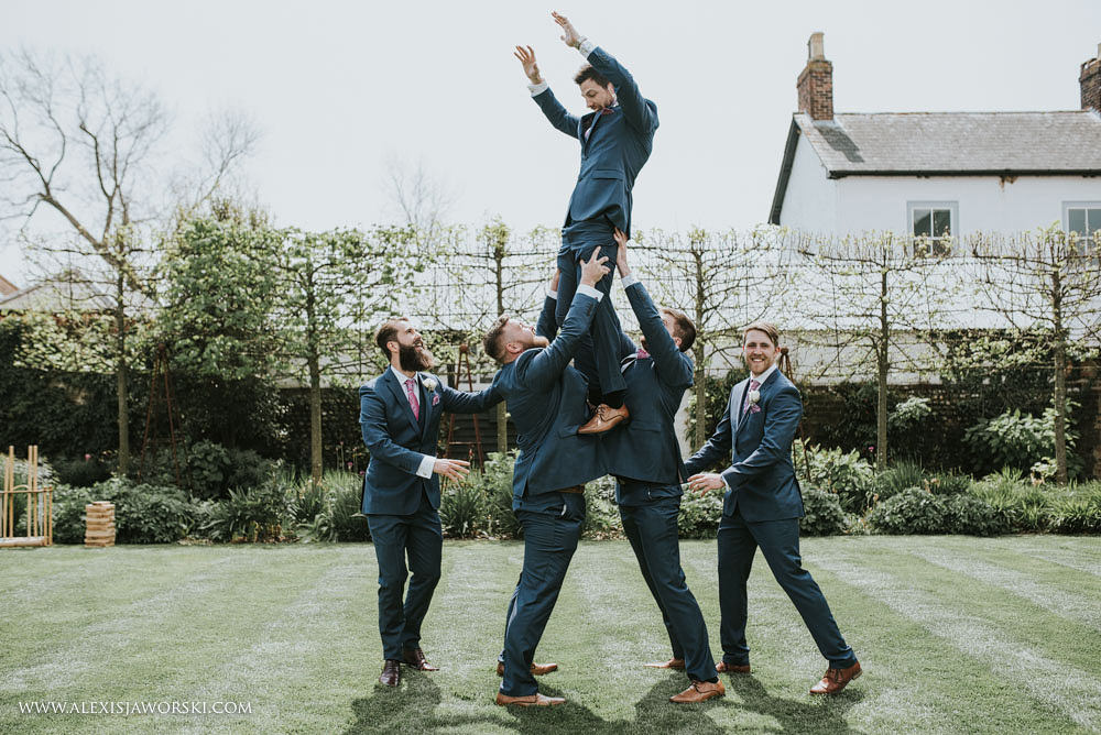 groom jumping in the air