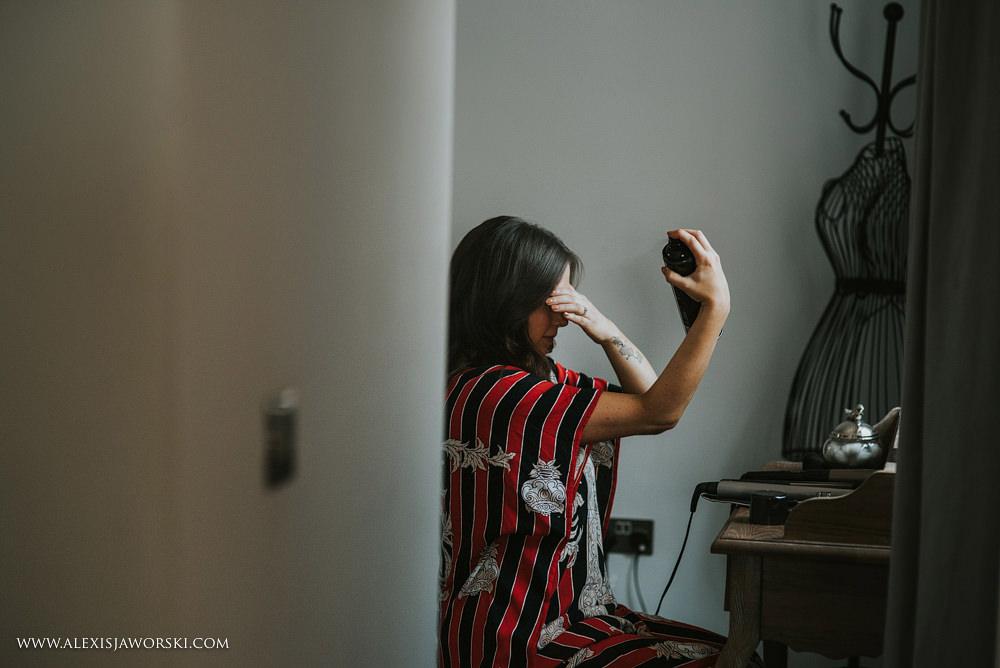 Bride putting hairspray on