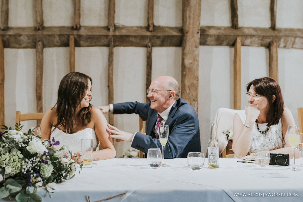gentle touch from dad to bride
