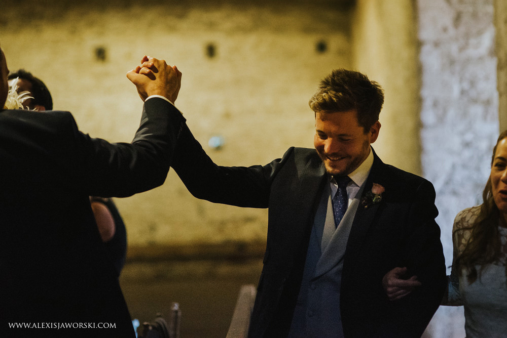 Groom high fiving a guest