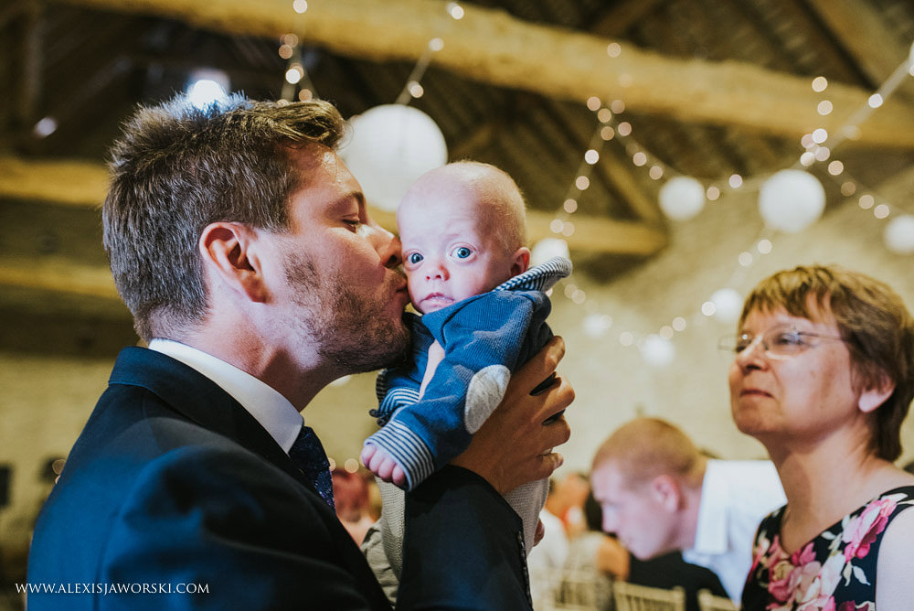 Groom kissing his baby nephew