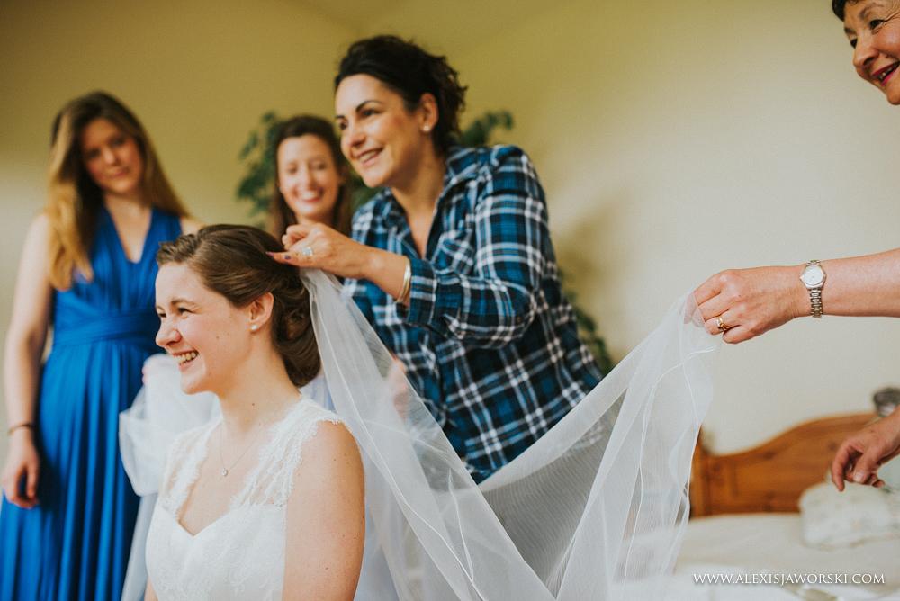 Bride having her veil adjusted
