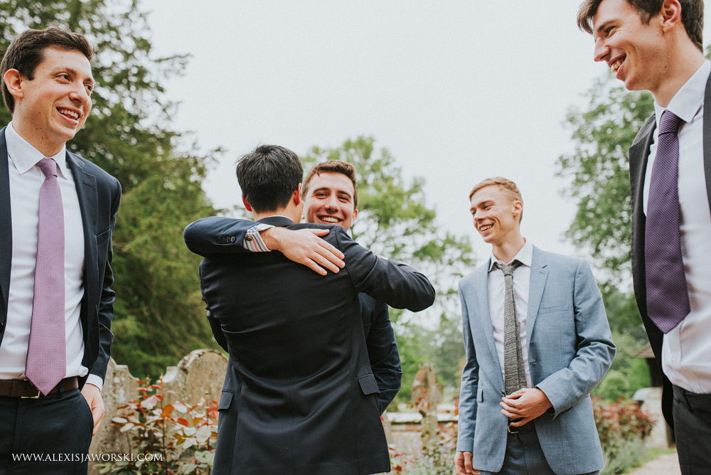 Groom greeting friends at the church
