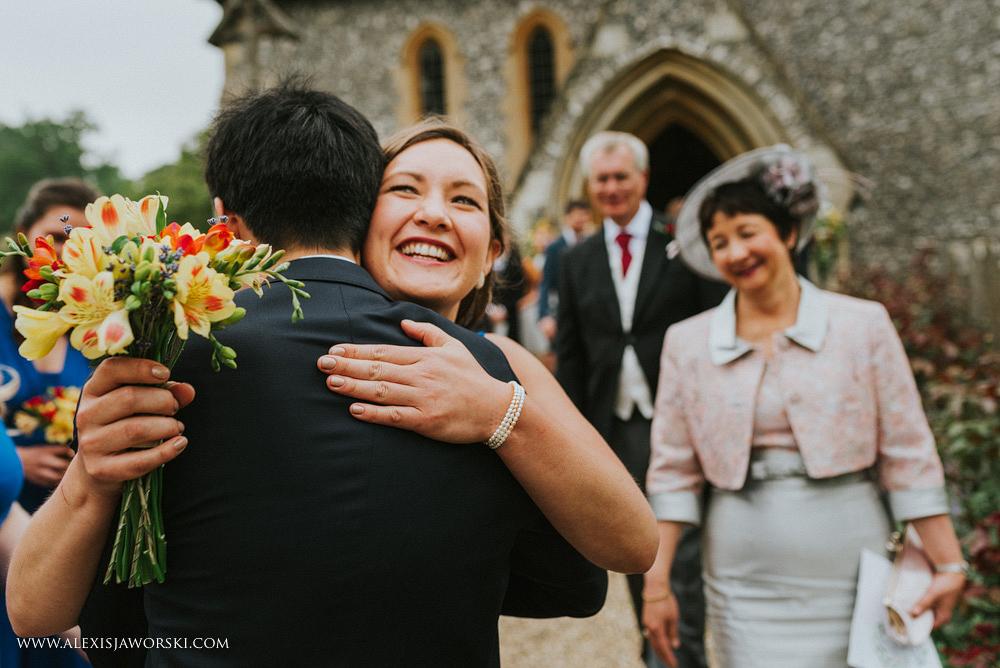 bridesmaid congratualting groom