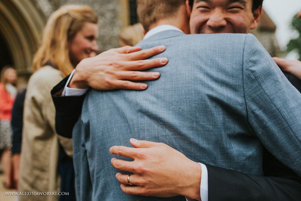 groom hugs friend