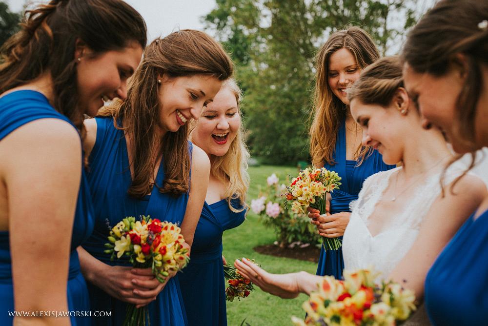 bridesmaids looking at the wedding ring