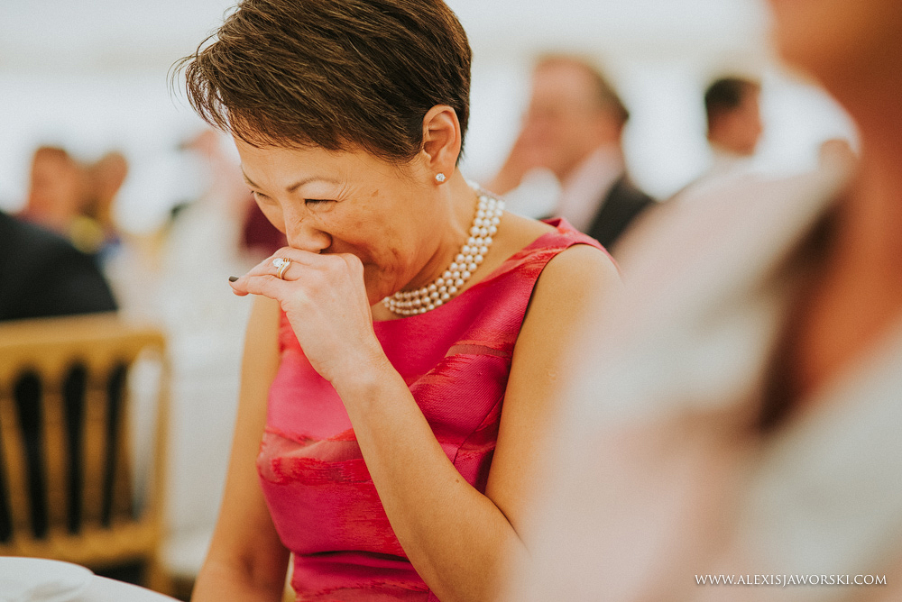 mother of the groom laughing at speeches