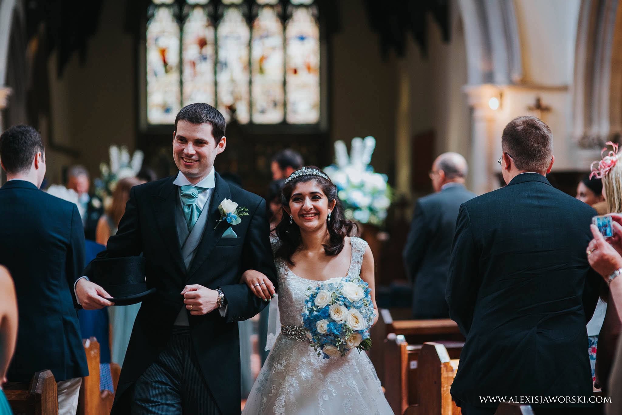 bride and groom smiling at guests