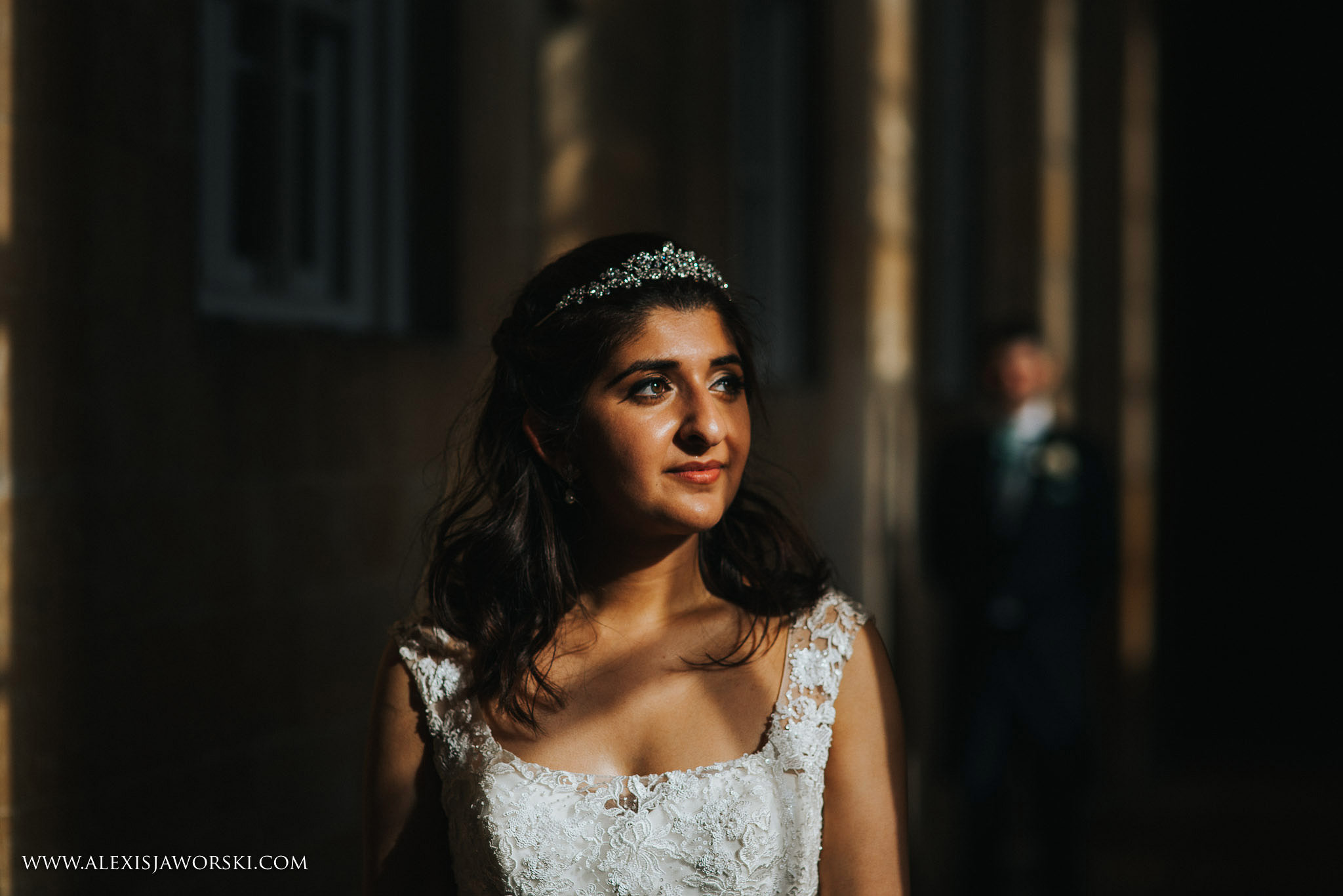 portrait of bride with groom in background