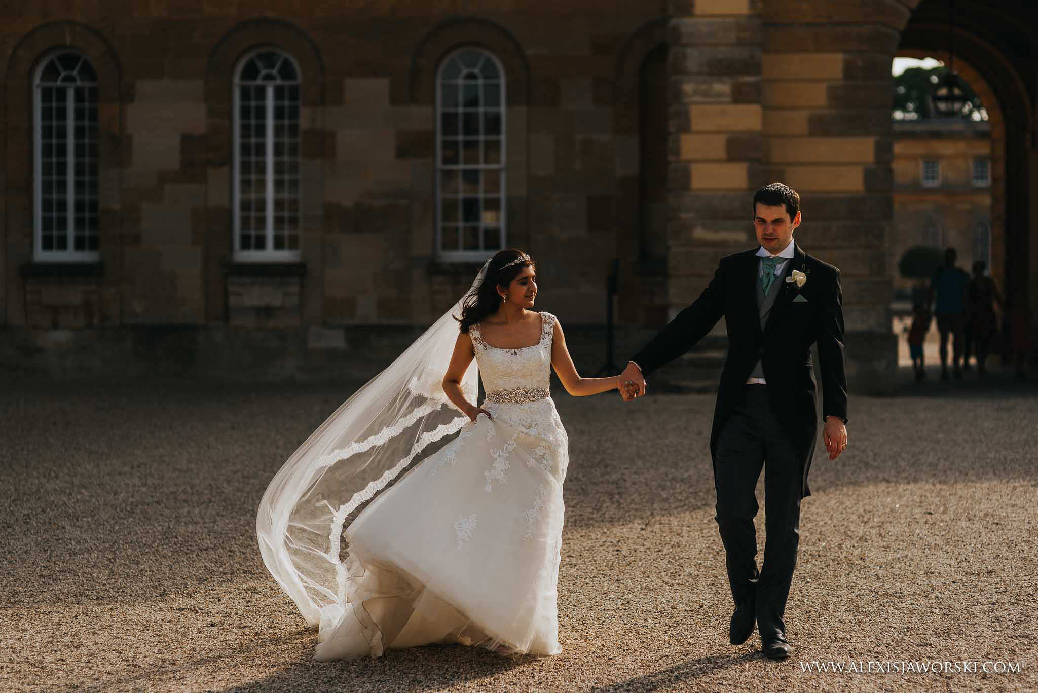 casual walking portrait of bride and groom