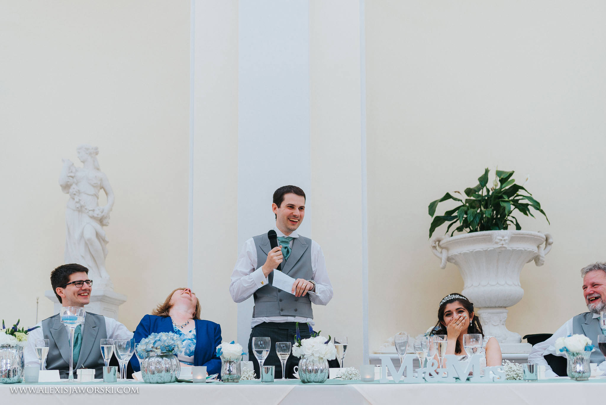 guests laughing at groom's speech