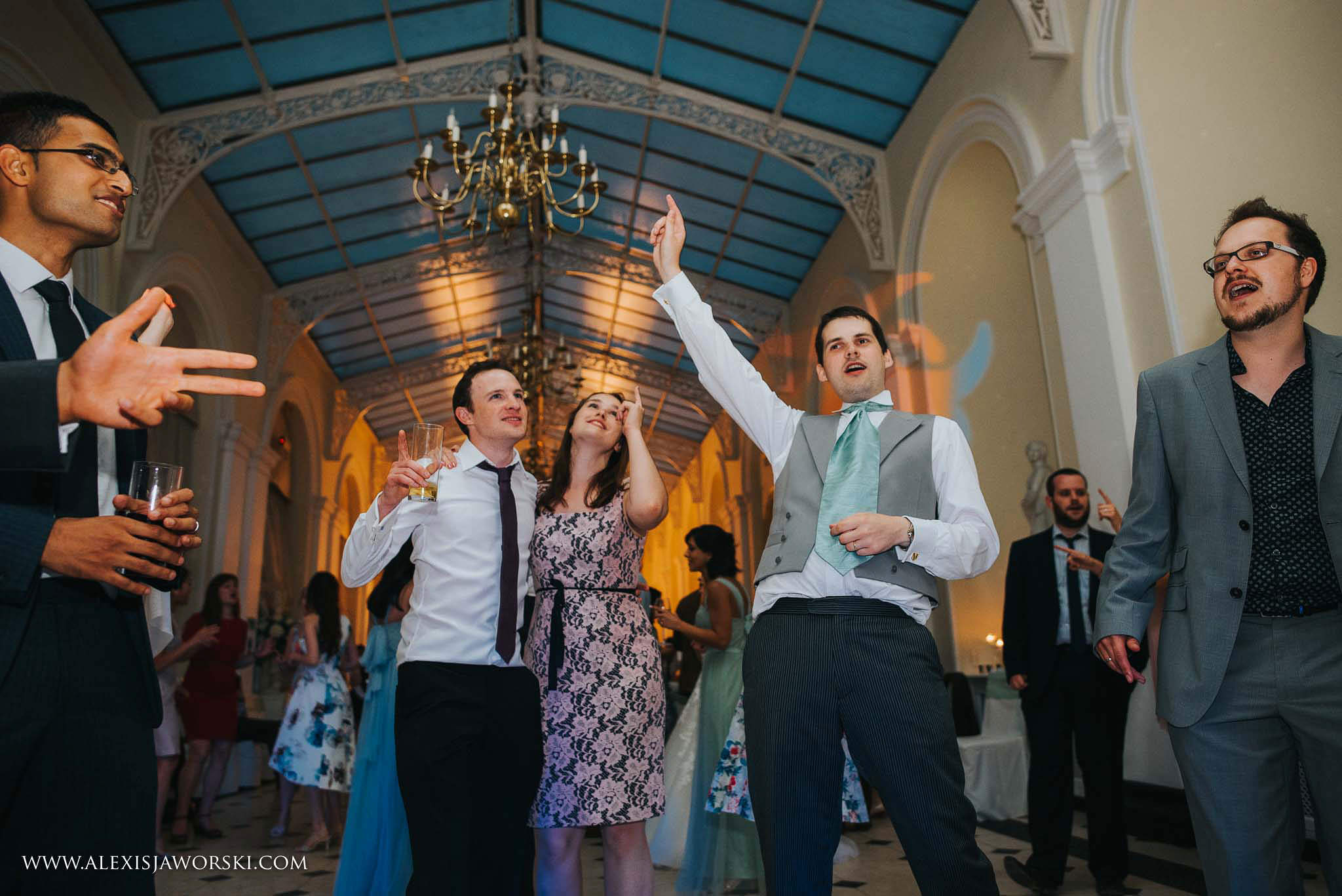 groom and friends adancing
