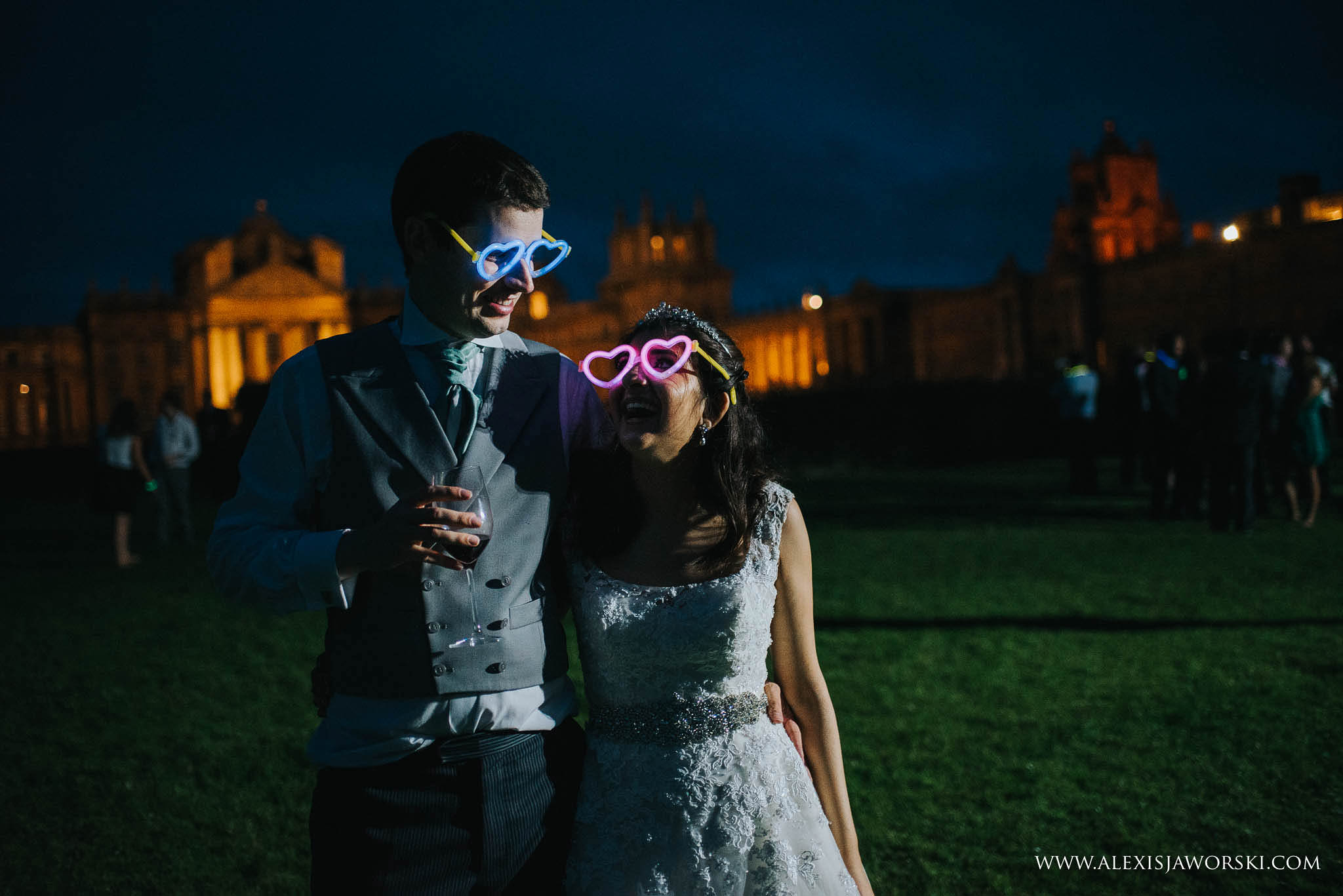 bride and groom wearing fluorescent glasses