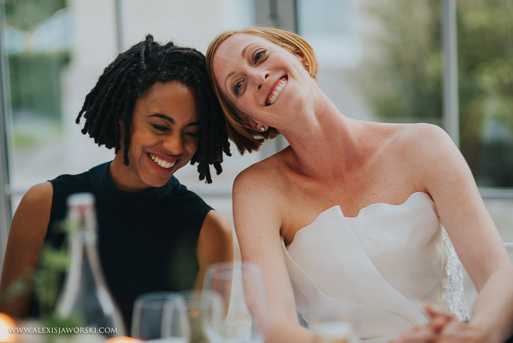bride and bridesmaid share a moment together