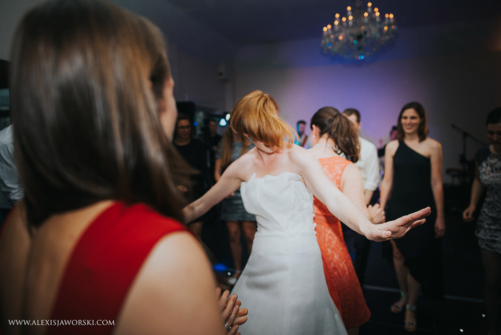 bride dancing with the friends