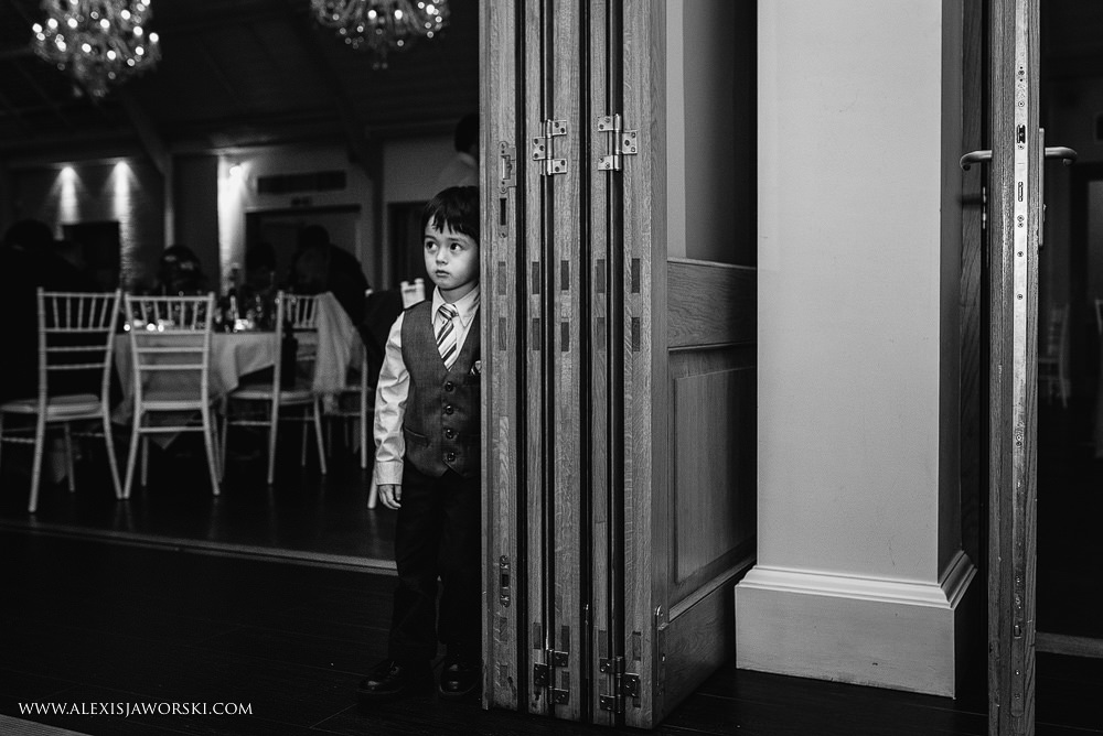 a little boy looks on at people dancing