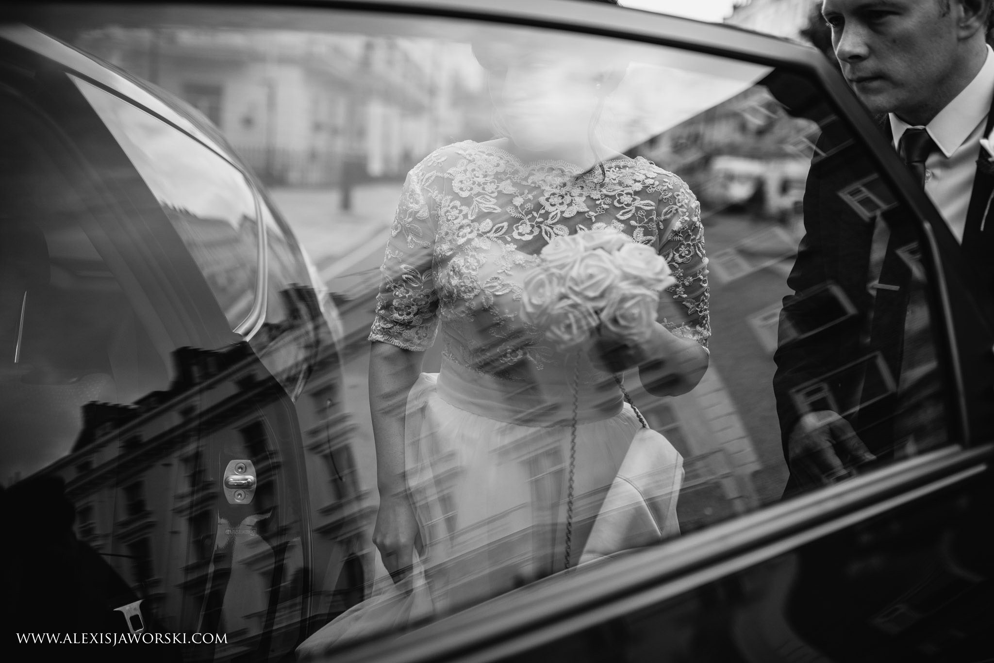 bride and groom jumping into a taxi