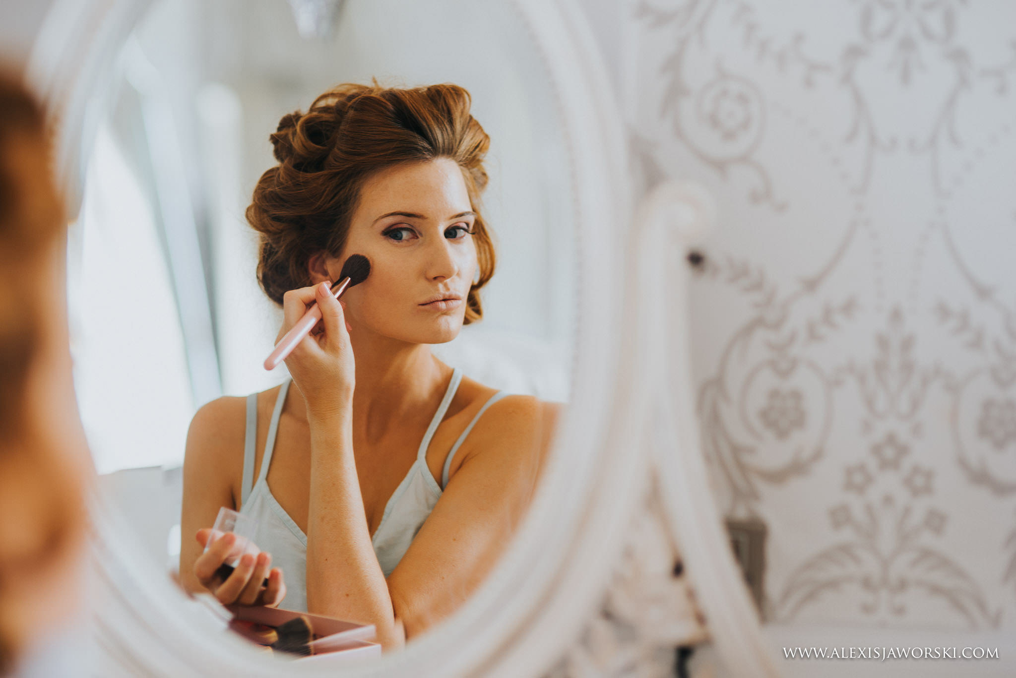 bride applying make up