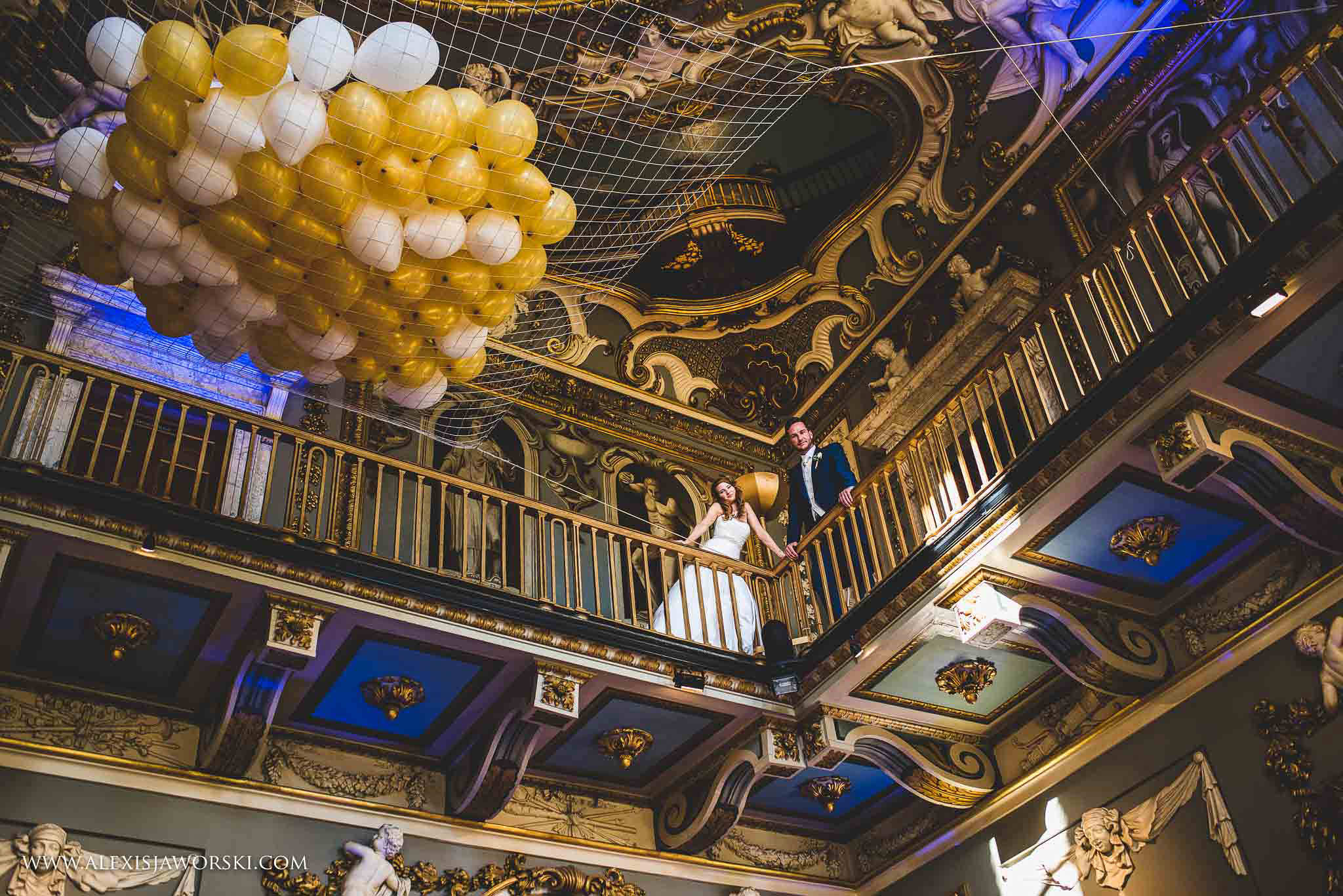 bride adn groom portrait and ballons
