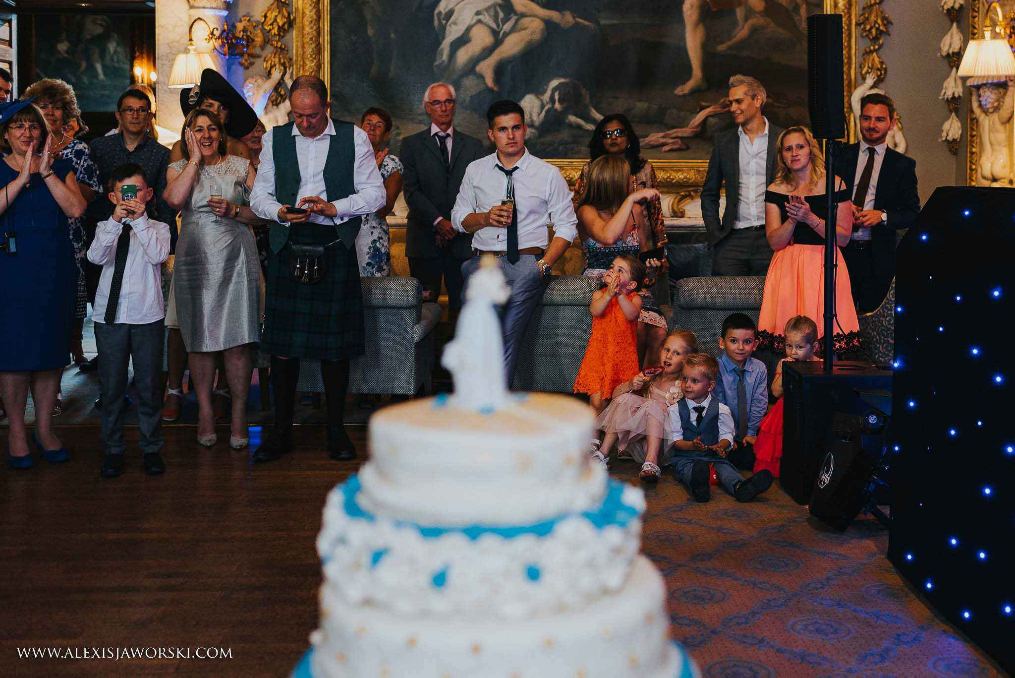 guest in background after cutting the cake