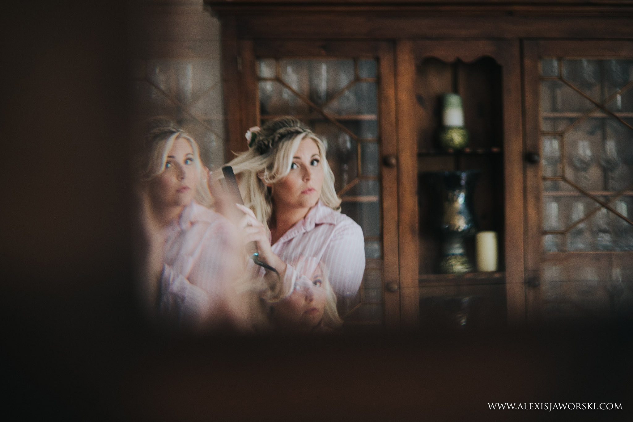 bride looking into mirror
