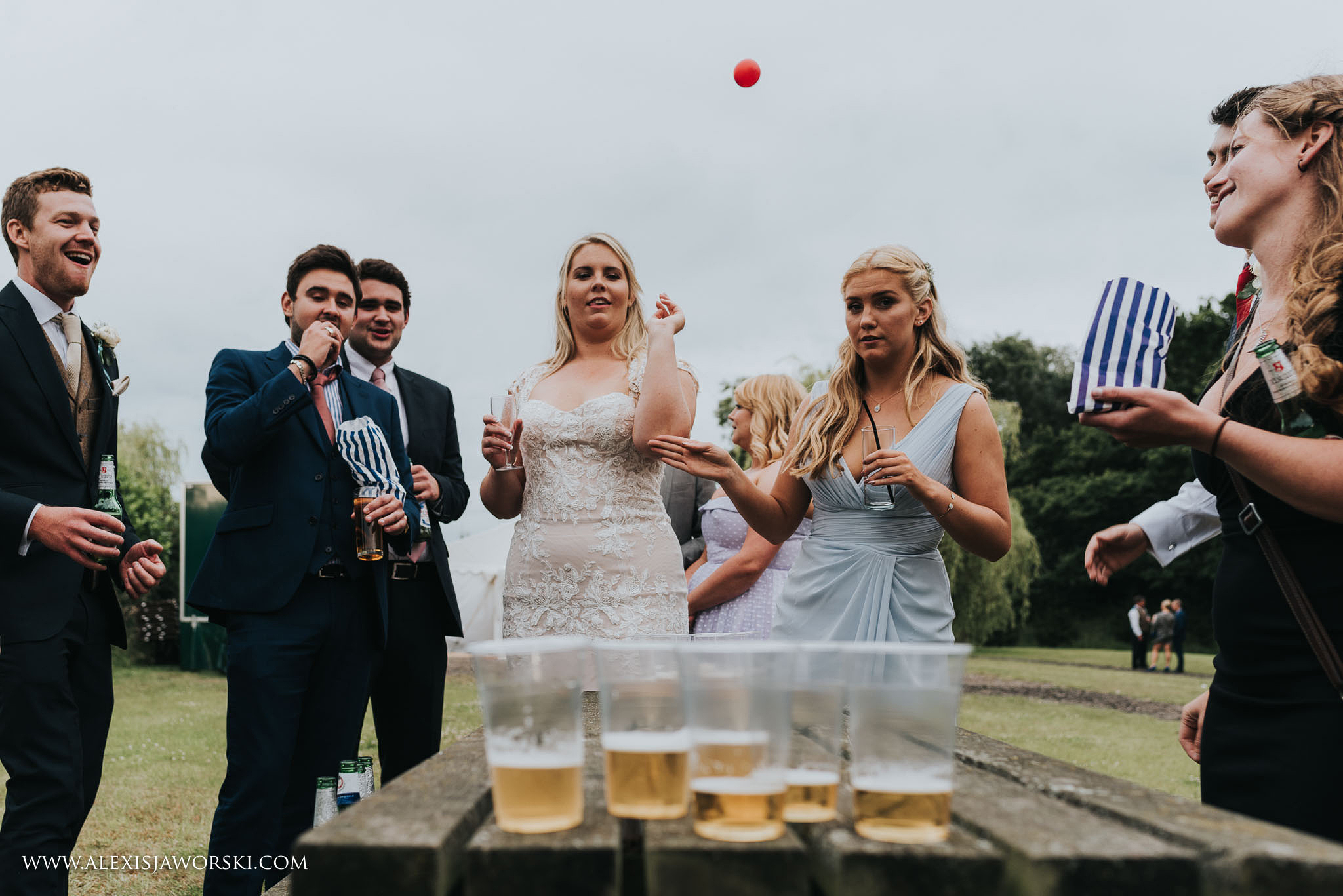 bride and groom playing beer pong