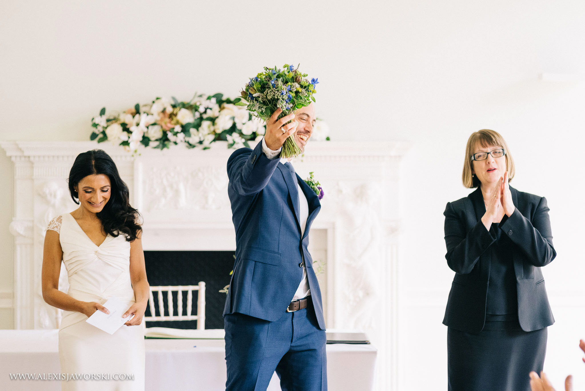 Groom punching the air with bouquet