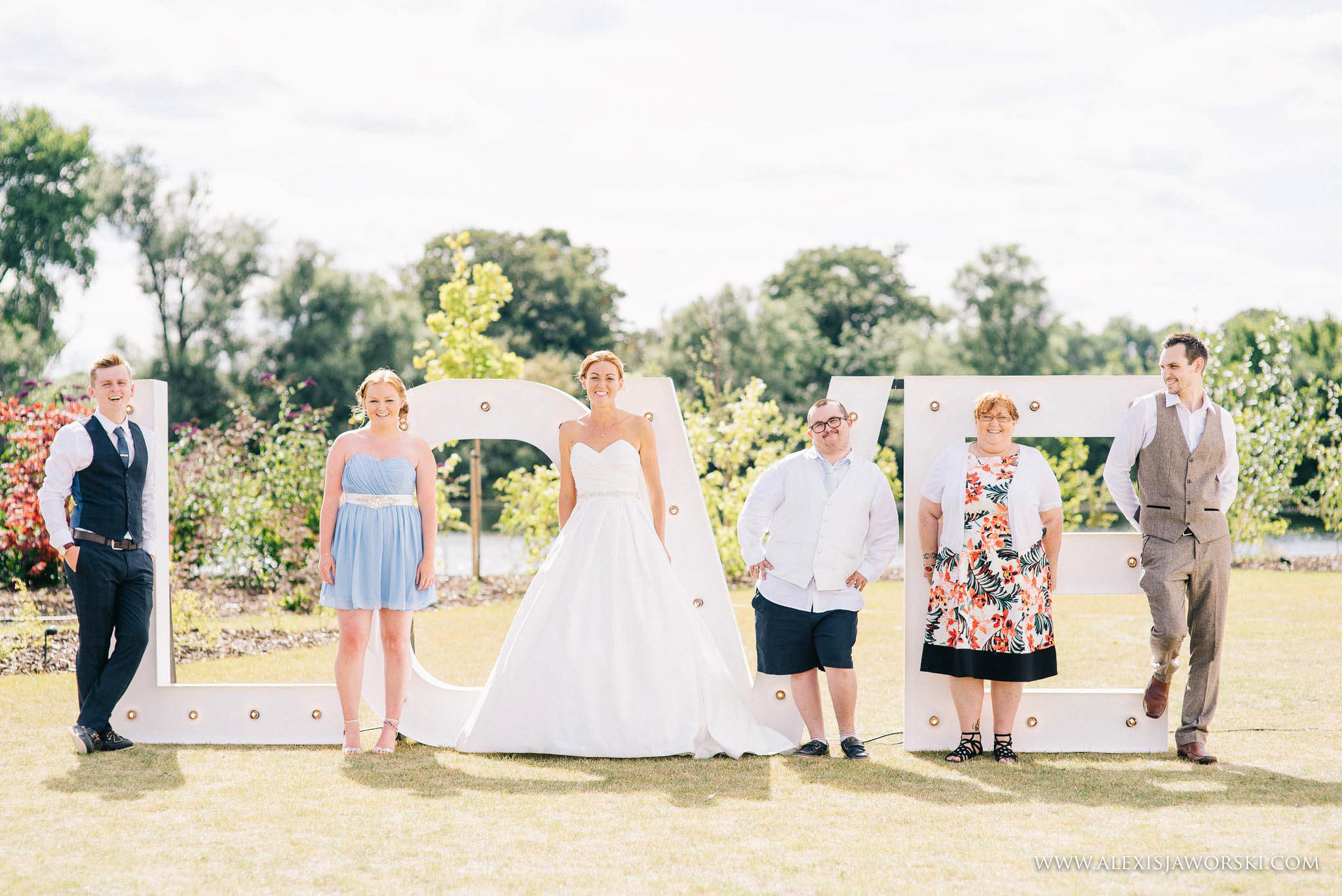 a fun posed portrait of the bride and siblings