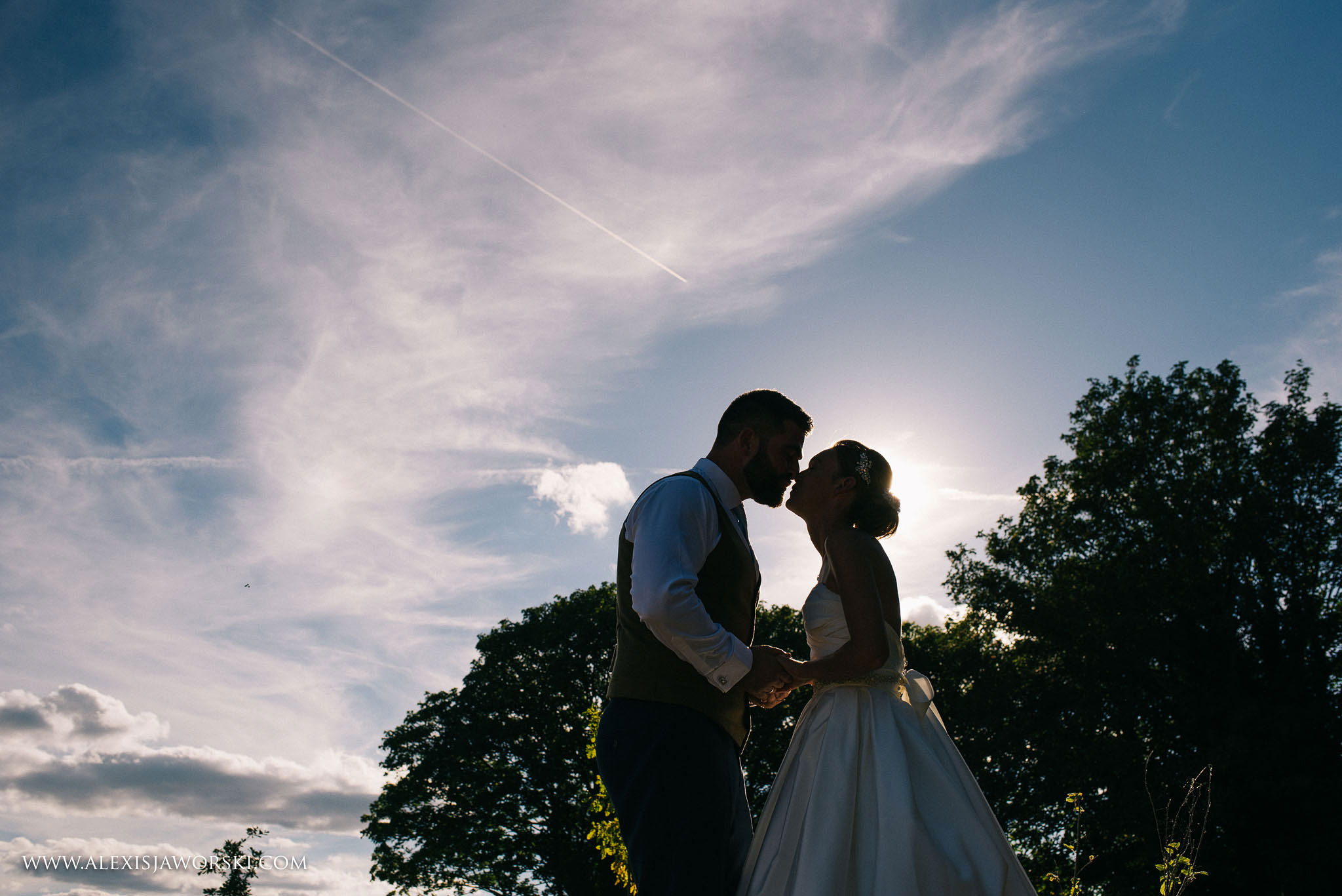 a silhouette portrait of the bride and groom