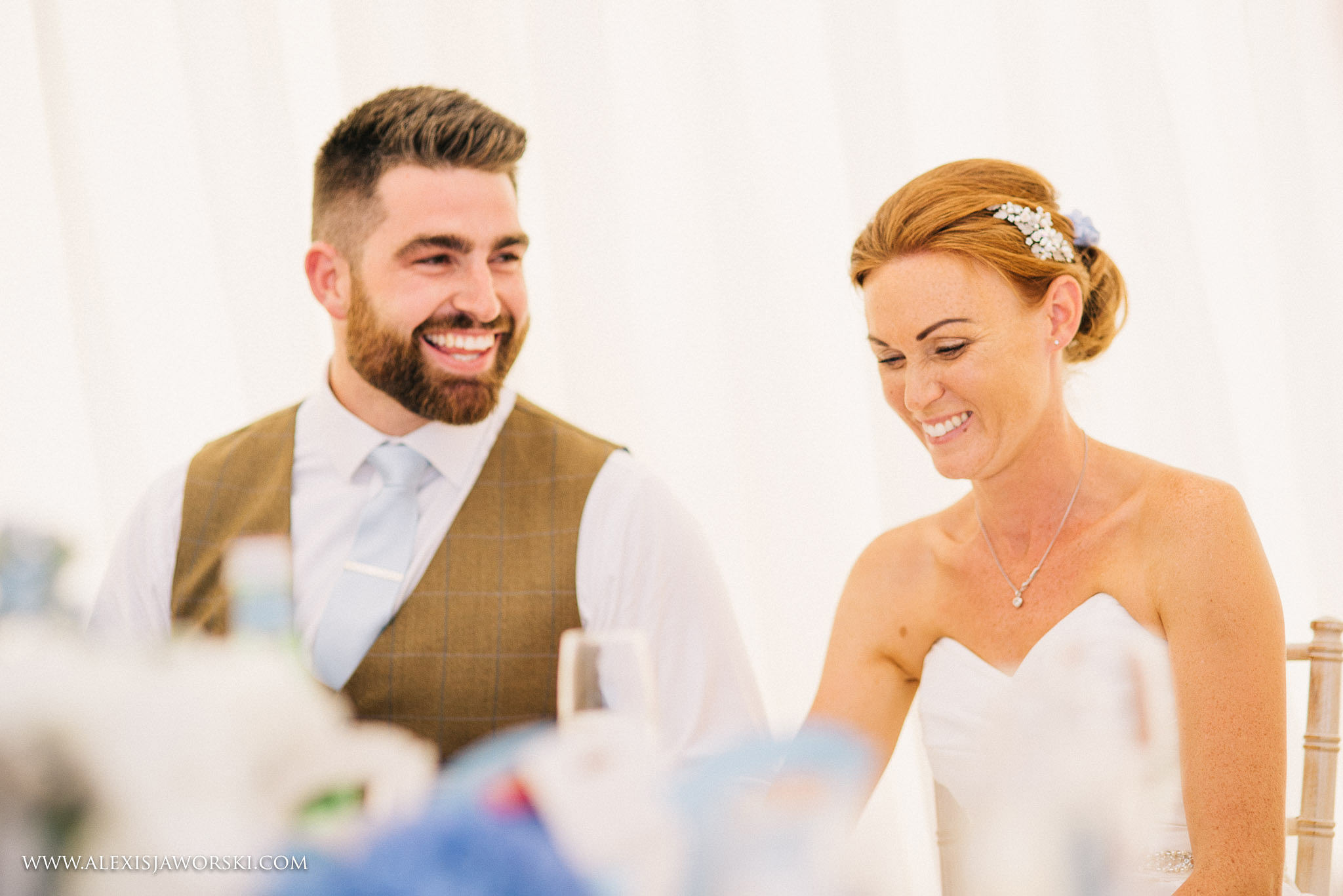 close up bride and groom smiling