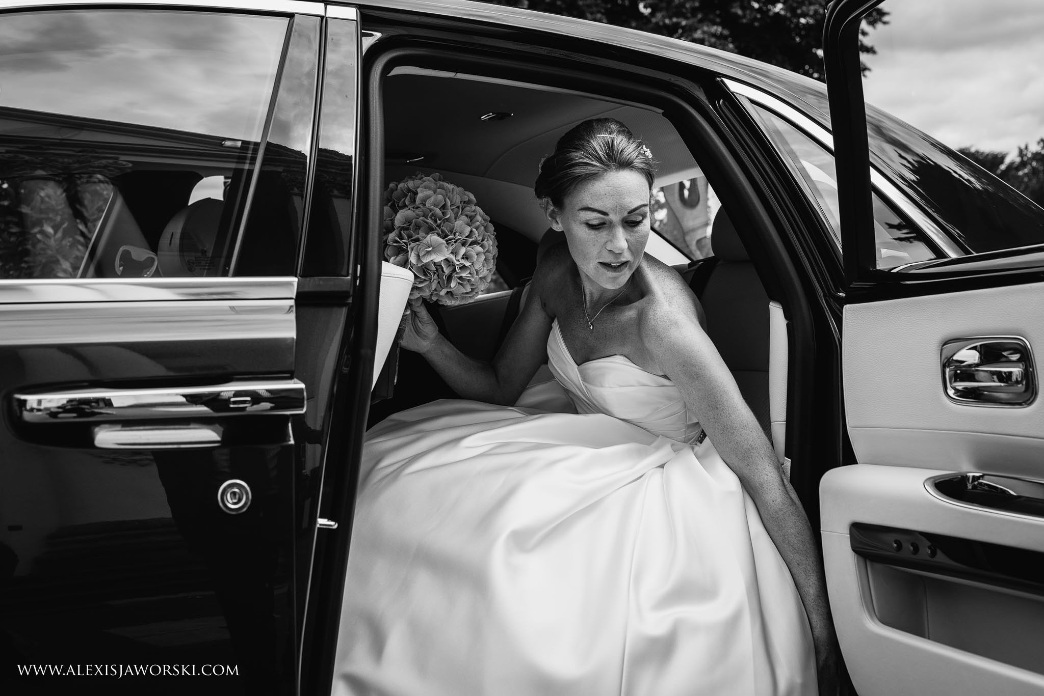 bride getting into car
