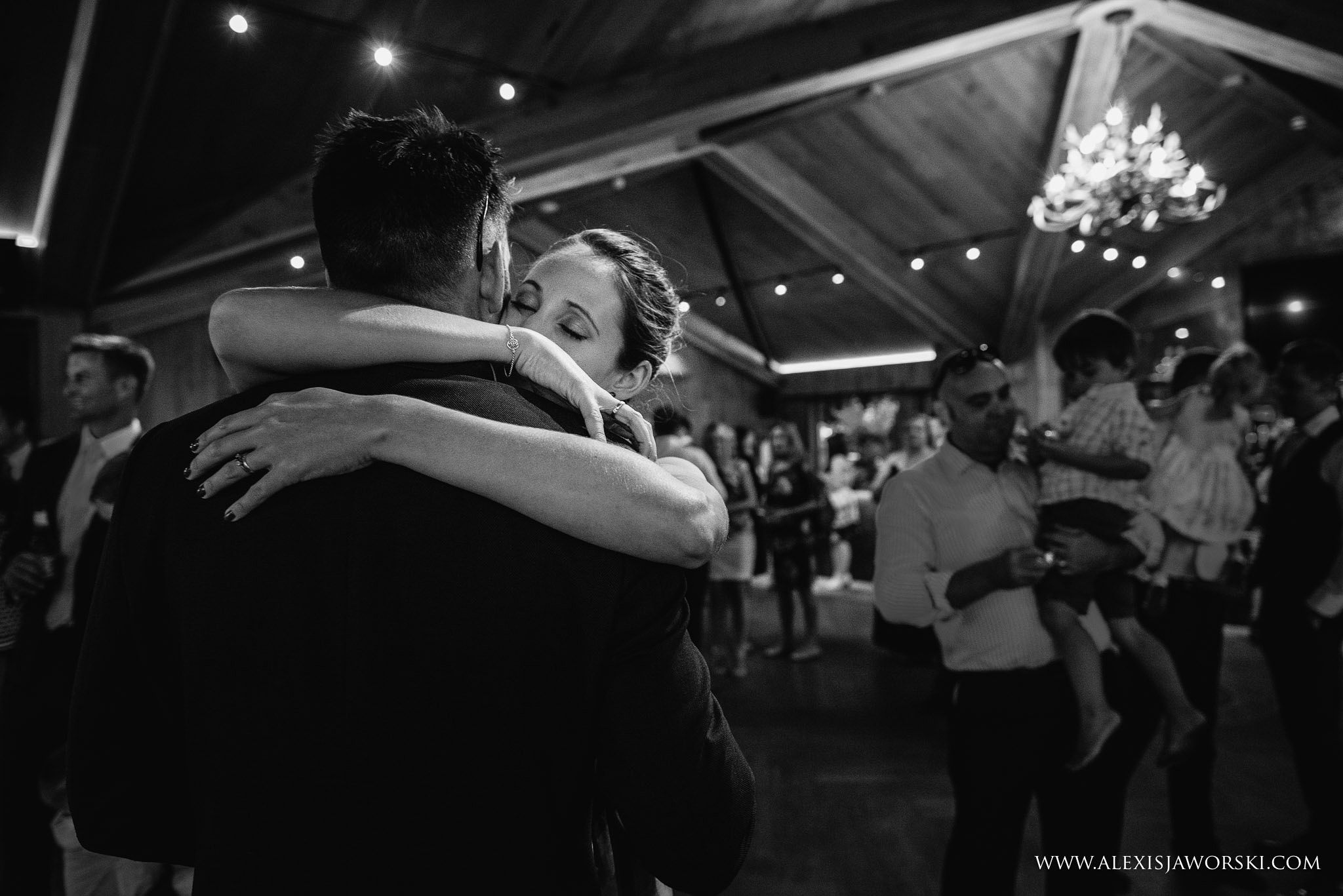 guests hugging and dancing
